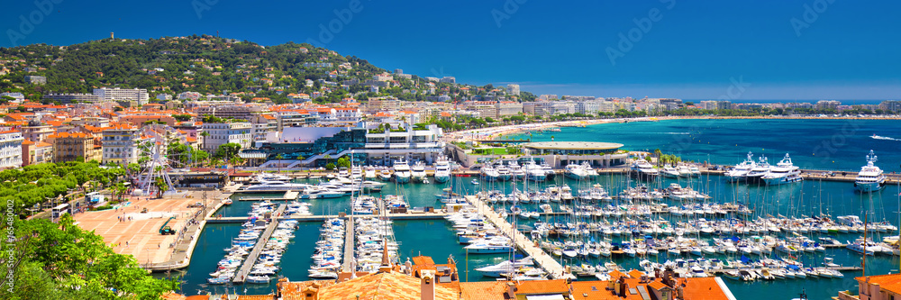 Fototapeta Coastline view on french riviera with yachts in Cannes city center.