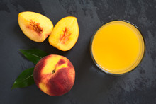 Peach Juice Or Nectar In Glass...