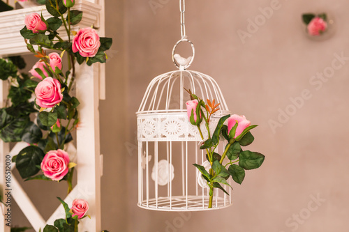 Fényképezés  Shabby chic decorating with beautiful vintage birdcage and flowers