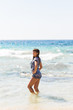 Sexy summer outdoor style beach sea vacation portrait of hot tanned beautiful sporty girl in tunic