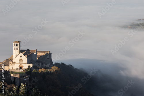 Beautiful view of St.Francis church in Assisi, over a sea of fog Canvas Print