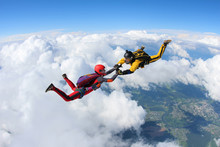 Two Skydivers Are In The Sky.