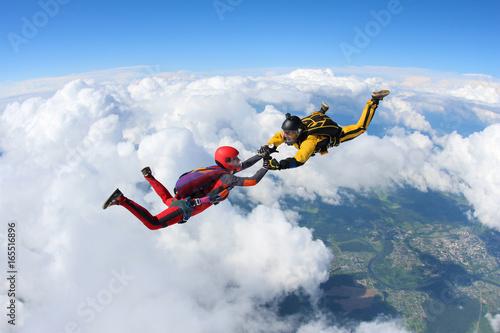 Obraz na płótnie Two skydivers are in the sky.