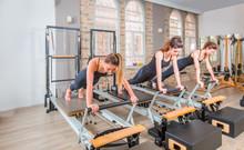 Young Women Exercising On Pila...