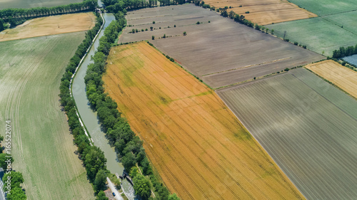 Papiers peints Olive Aerial top view of Canal du Midi and vineyards from above, beautiful rural countryside landscape of Southern France