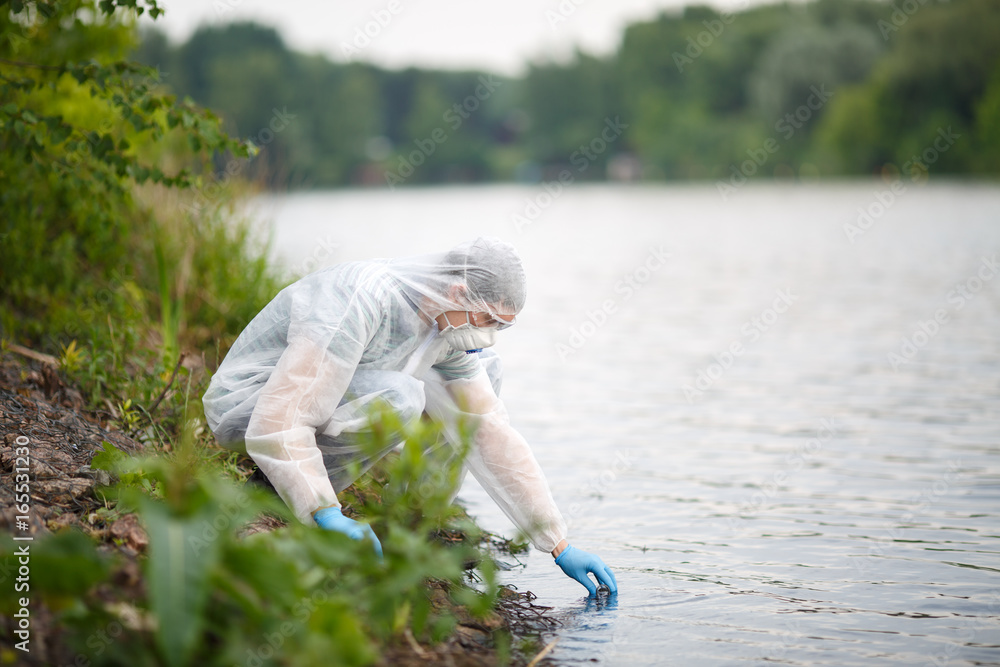 Valokuva  Ecologist takes sample of water