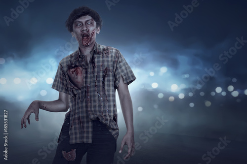 Fotobehang Volle maan Aggressive spooky asian zombie man walking