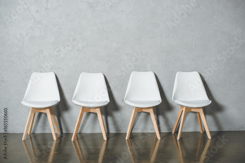 Fotografie, Obraz  white empty chairs for job interview standing in line in hall