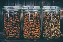 Nuts In Jars On A Background O...
