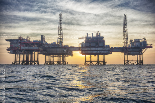 Fototapeta HDR of Offshore oil platform in The Middle of The Sea at Sunset Time  obraz