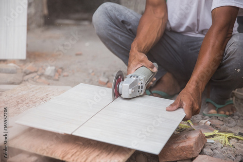 Cutting A Tile Using An Angle Grinder Buy This Stock Photo And