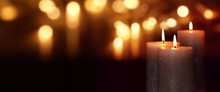 Burning Candles At Night With Golden Bokeh