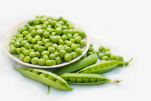Green Pea And Pods In A Bowl Of Top View On White Background With Copy Space - Healthy Food - Flat Lay