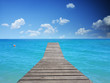 Tropical beach - blue water with wooden floor