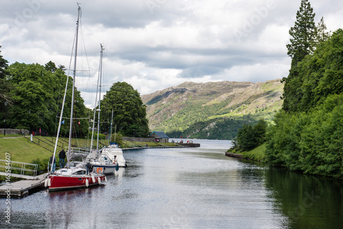 Fényképezés Docked boats on the Caledonian Canal at the southwest end of Loch Ness, Scotland