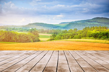 Landscape Of Golden Wheat Field In Summer Season With Wood Top Surface