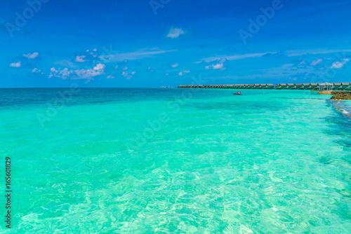 Fotobehang Turkoois Beautiful water villas in tropical Maldives island .