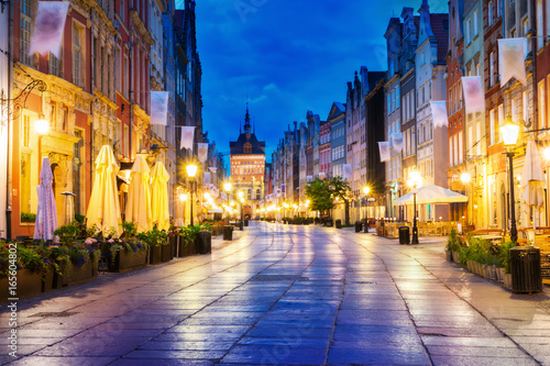 obraz dibond Gdansk long street at night. In the background the Gold Gate.