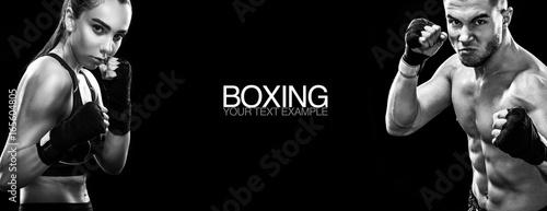 Valokuva  Two sportsmans boxers on black background