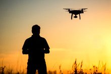 Young Man Operating Of Flying Drone The Setting Sun
