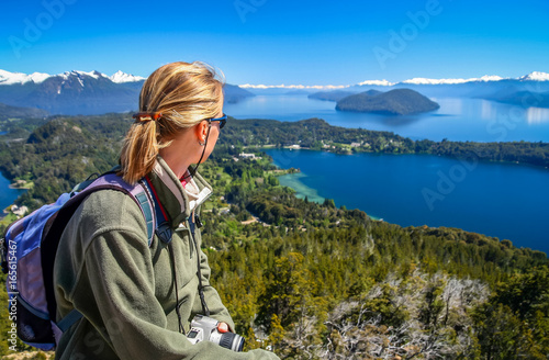 Girl admiring the beauty of argentinian Lake District Wallpaper Mural