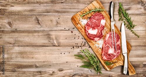 Foto op Aluminium Vlees Raw meat Ribeye Steak herbs spices Rib eye