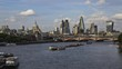 London city Time-Lapse from the Waterloo Bridge with the view of the skyscrapers, the St Paul's Cathedral and the busy Thames with many boats.