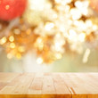 Wood table top on blurry gold background - festive background concept