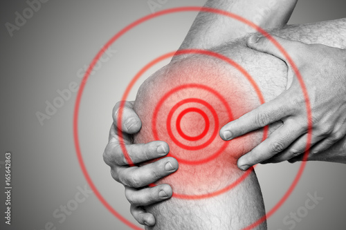 Acute pain in a knee joint, close-up Wallpaper Mural