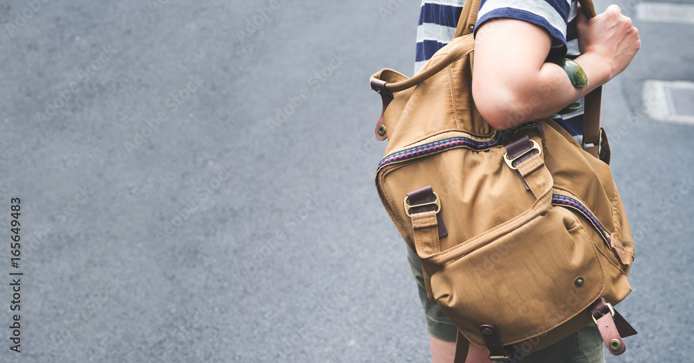 Fototapety, obrazy: Close up backpack at back of woman traveler walking on street to sightseeing town,Travel concept,leave copy space for adding text