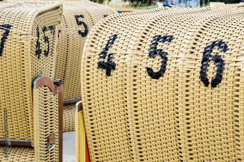 Fotobehang Noordzee European Beach wicker chairs
