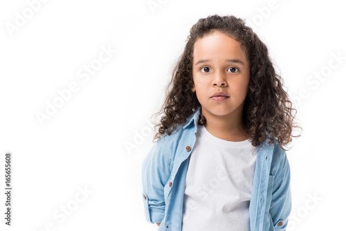 Valokuva  portrait of adorable african american girl looking at camera isolated on white