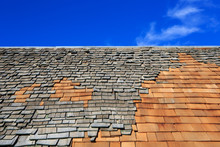 Roof Construction Site. Removal Of Old Roof, Replacement With New Shingles, Equipment And Repair.