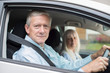 Portrait Of Smiling Senior Couple On Car Journey Together