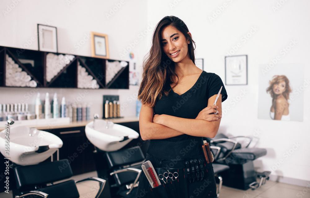 Fototapety, obrazy: Female hairdresser standing in salon