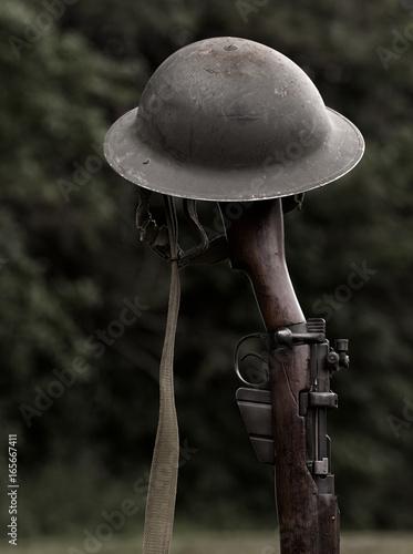 Photo World war era rifle and helmet