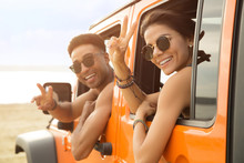 Smiling Multiethnic Couple Sitting In A Car
