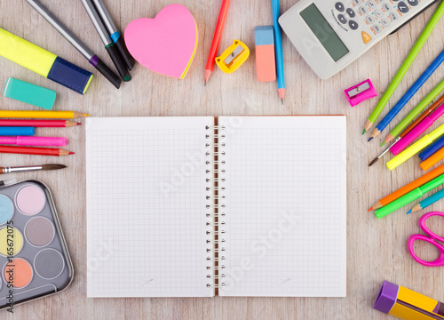 Obraz School supplies on wooden desk wirh open notebook - fototapety do salonu