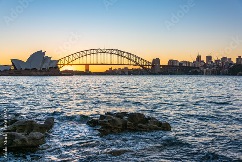 Sydney Harbour Bridge and cityscape at sunset
