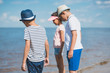 selective focus of multicultural little children standing at seaside