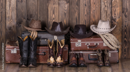 Fotografia, Obraz  Old suitcases, hats and cowboy shoes