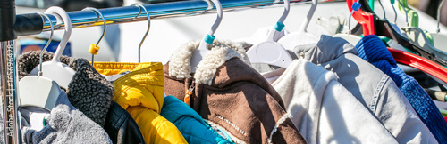 Fotografie, Tablou  used baby winter clothes, jackets and coats displayed on rack