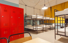 Interior Of The Students Hostel With Modern Bunk Beds And Locker For Personal Things