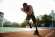 Leinwanddruck Bild - Young african runner running on racetrack