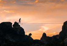 An Acrobat Walking The Slackline