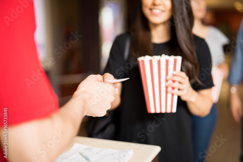 Woman ready to watch a movie at the theater