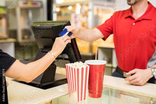 Woman paying for snacks at the movies