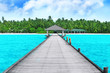 Wooden pontoon at tropical resort on summer day