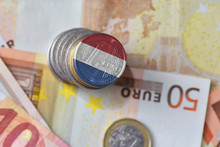 Euro Coin With National Flag Of Netherlands On The Euro Money Banknotes Background.