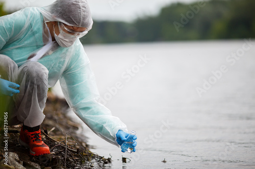 Valokuva  Ecologist takes water for examination